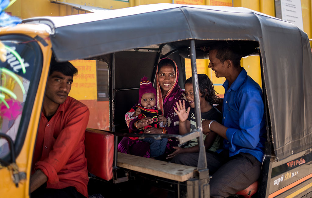 Bhumika returning home after receiving treatment in a an Action Against Hunger treatment centre in India