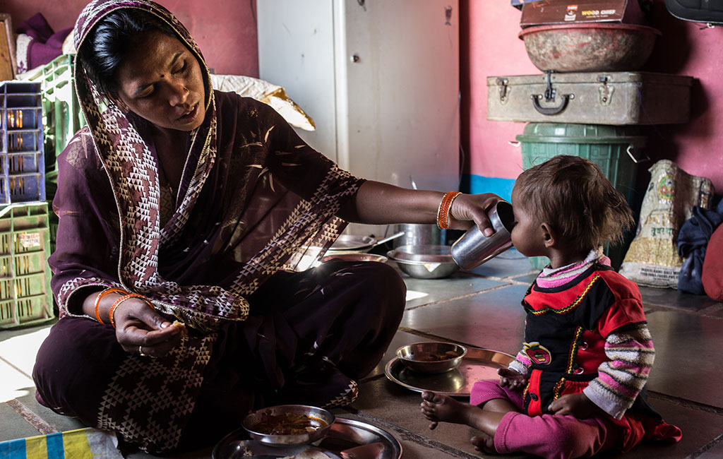 Bhumika safely back at home with her mother, Sunita feeding her the right food to keep her healthy