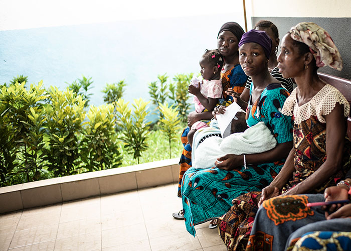 Women sitting on a bench in Cote D'Ivoire