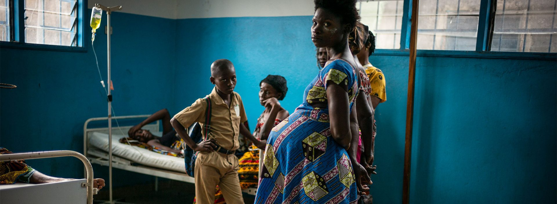 Pregnant lady looking to camera in Cote D'Ivoire