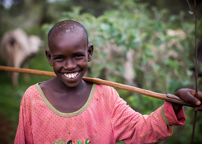 Young farmer smiling to camera in Ethiopia