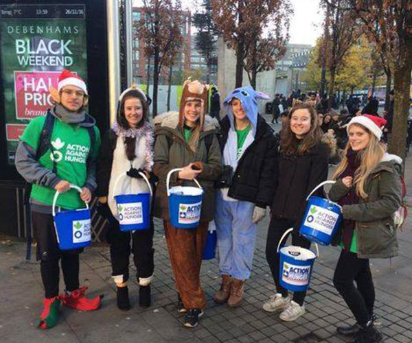 Faith group doing a bucket collection at Christmas for Action Against Hunger