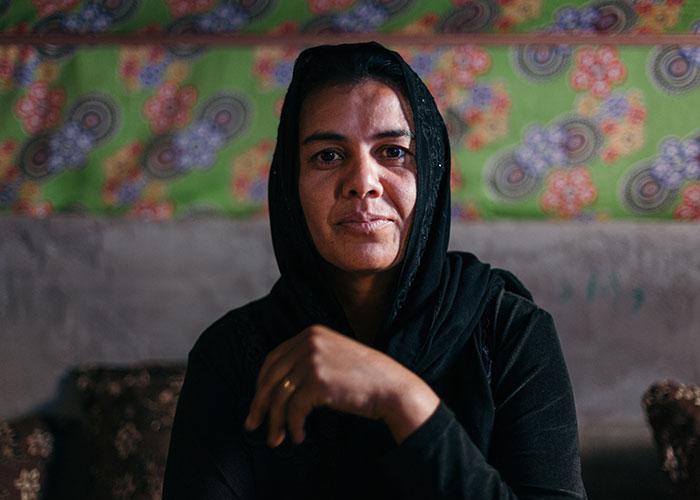 Iraqi woman looking to camera