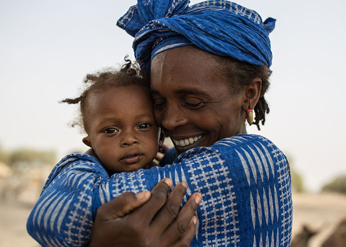 Woman hugging her daughter in Mauritania