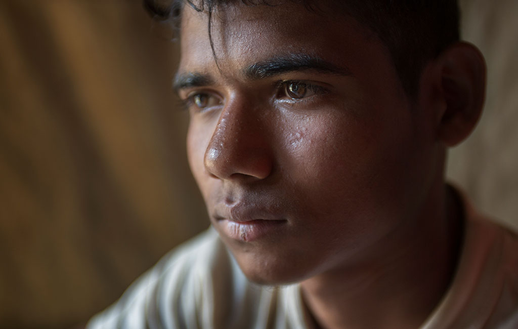 17 year old Mohammed Riaz , among young men and adolescents at a men's stress management session in the Balukali camp