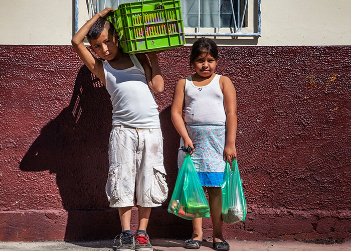 Children carrying food and crates in Nicaragua