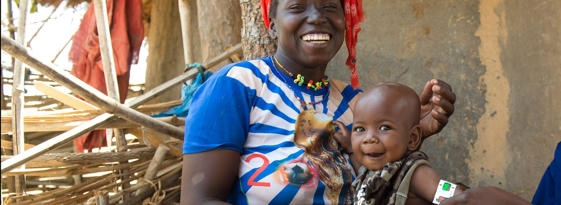 Healthy baby with her mother after benefiting from Action Against Hunger programme in Mali