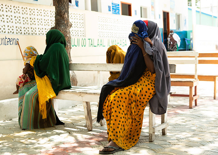 Women social distancing as they wait for appointments for nutrition treatments during the Covid-19 pandemic