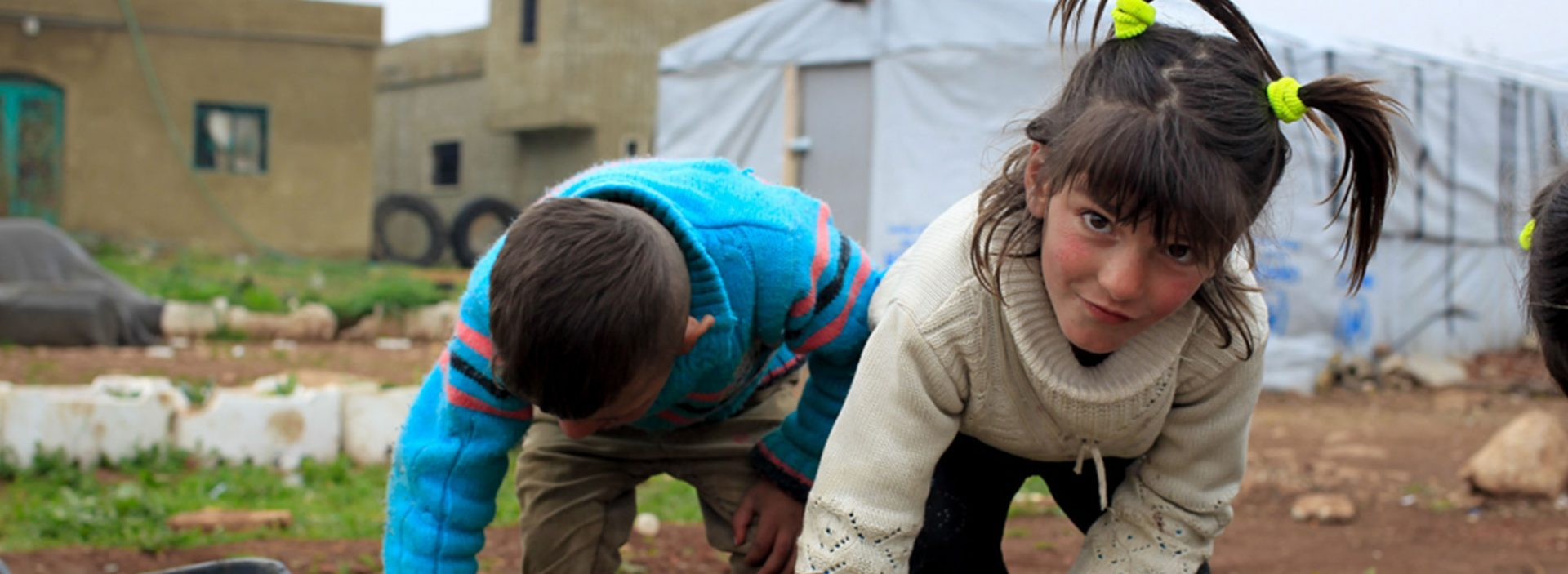 Syrian refugees planting seeds