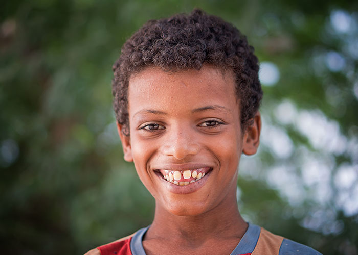 Ali next to the mobile clinic in his village in Abyan province, Yemen.