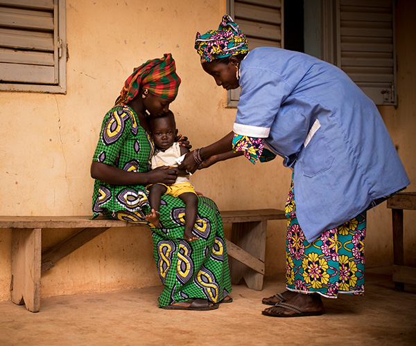 A boy is screened for malnutrition at an Action Against Hunger treatment centre in Mali.
