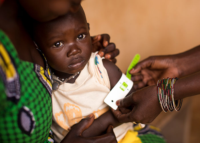 A child being screened for malnutrition at an Action Against Hunger health centre in Mali.