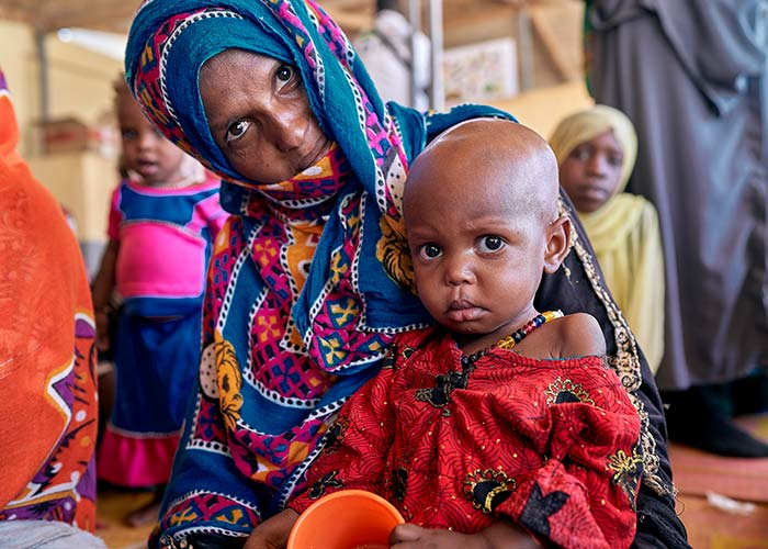A mother and their child at an Action Against Hunger treatment centre in Chad.