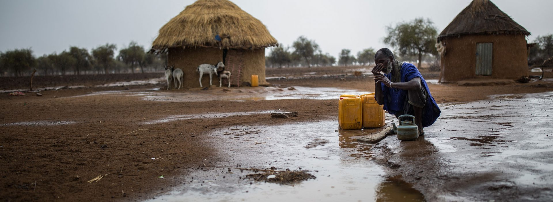 Mamadou prays as the first rains of the year arrive in Mauritania.