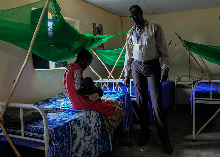 Dr David Gai Zakayo treats a patient at Action Against Hunger health centre in South Sudan.