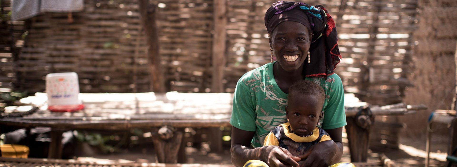 A woman and her child in Mali. They've been supported by Action Against Hunger's community health workers.