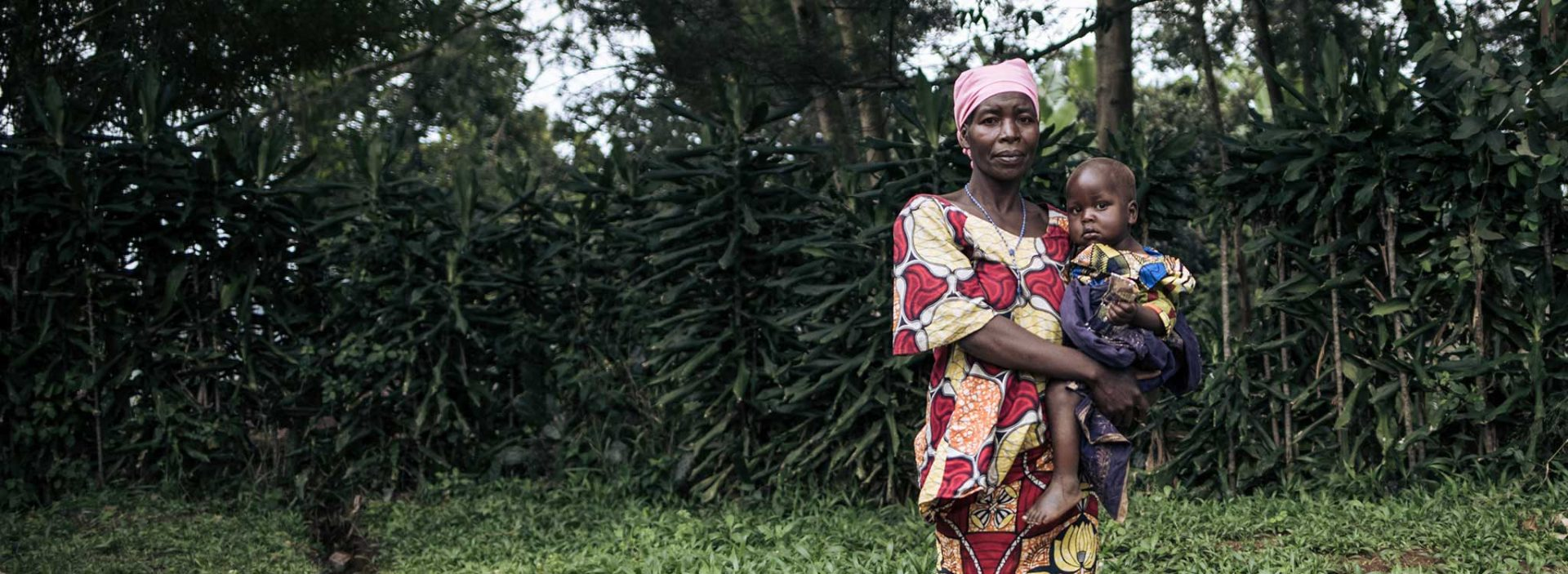 A woman and a child at an Action Against Hunger project in Democratic Republic of Congo.