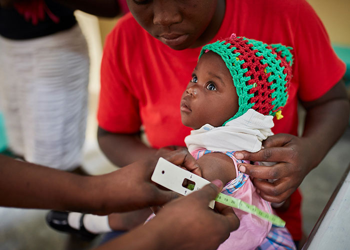 A child is screened for malnutrition at an Action Against Hunger treatment centre in Haiti.