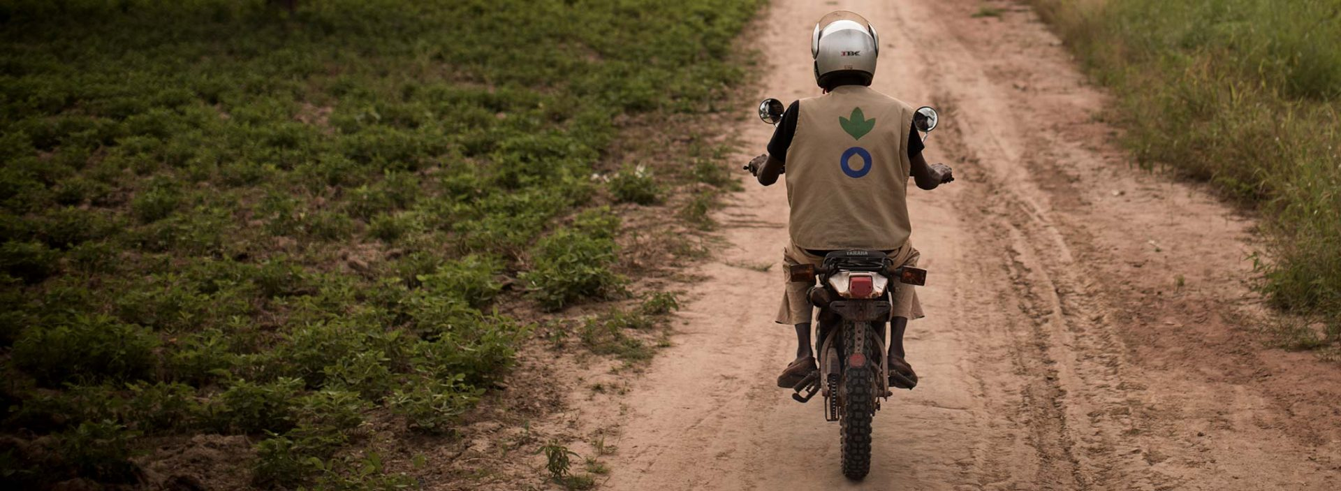 Ibrahim, an Action Against Hunger community health worker, on his motorbike in Mali.