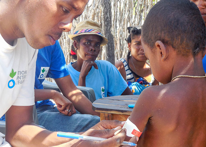 An Action Against Hunger staff member treats a child for malnutrition in Madagascar.