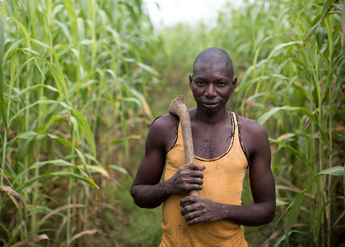 A man walks in a field at an Action Against Hunger project in Mali.