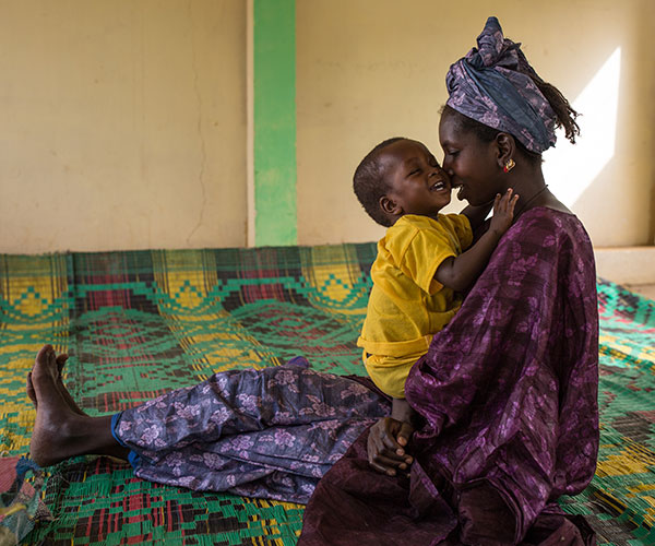 Ousmane and his mum at an Action Against Hunger project in Mauritania.