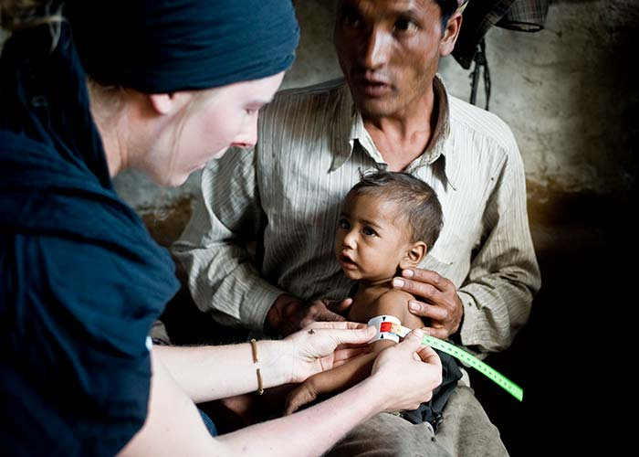 A child is screened for malnutrition at an Action Against Hunger treatment centre in Nepal.