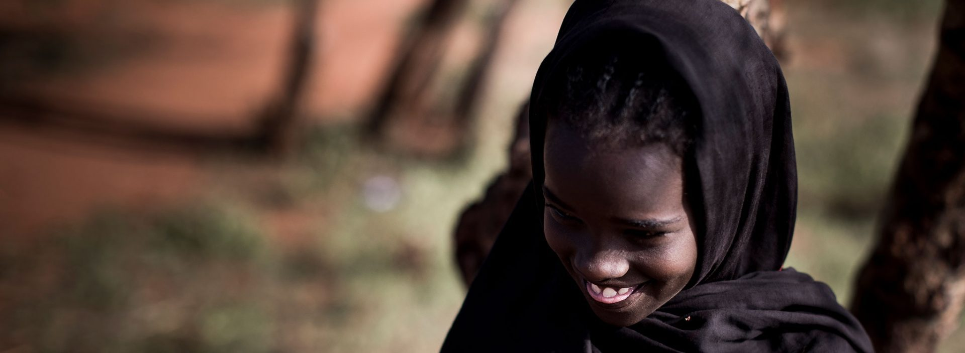 A girl sticking her tongue out in Ethiopia.