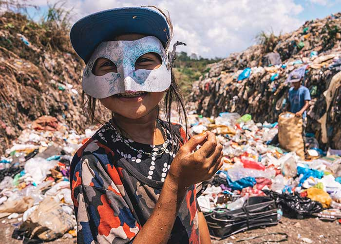 A girl on a rubbish dump in the Philippines.