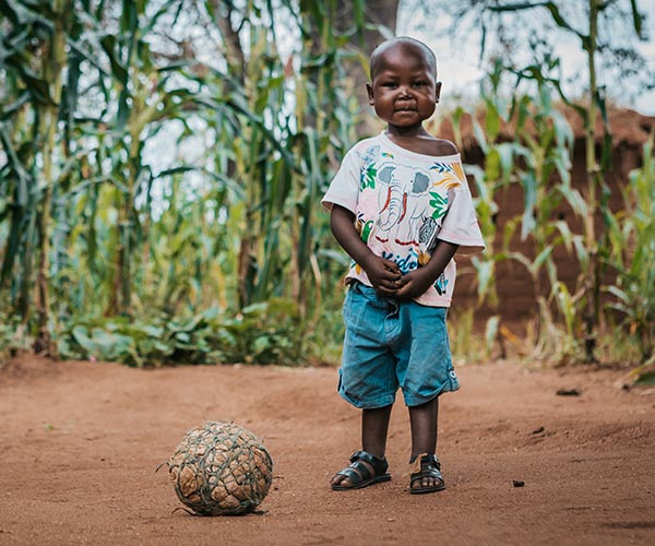 Rodrick, a four-year-old boy from Tanzania who has recovered from malnutrition thanks to support from Action Against Hunger.