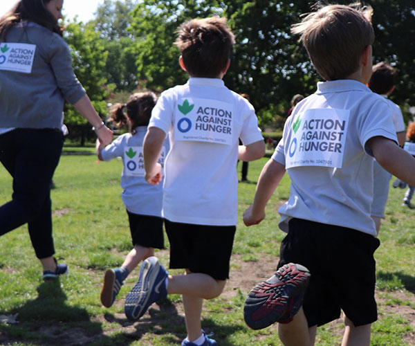 Children running a race at their school for Action Against Hunger