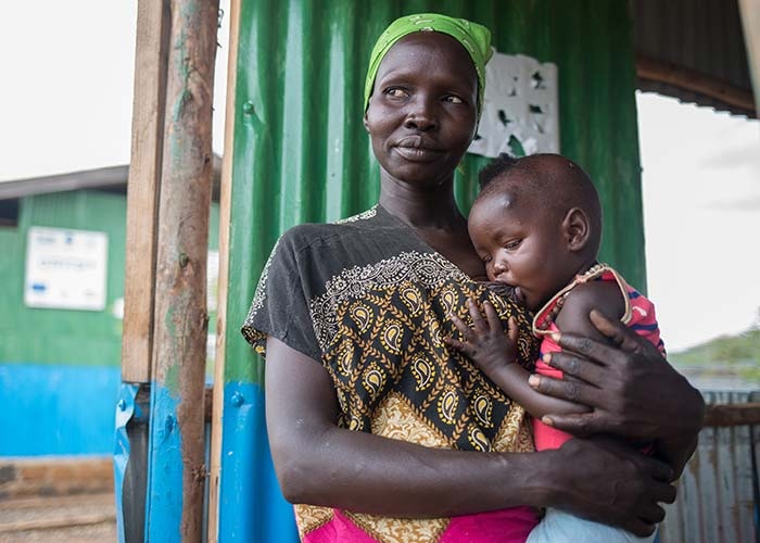 Nyalat, a South Sudanese refugee, with her baby after receiving mental health support from Action Against Hunger.