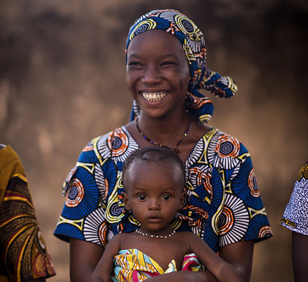 A smiling mother and her child in Mali.