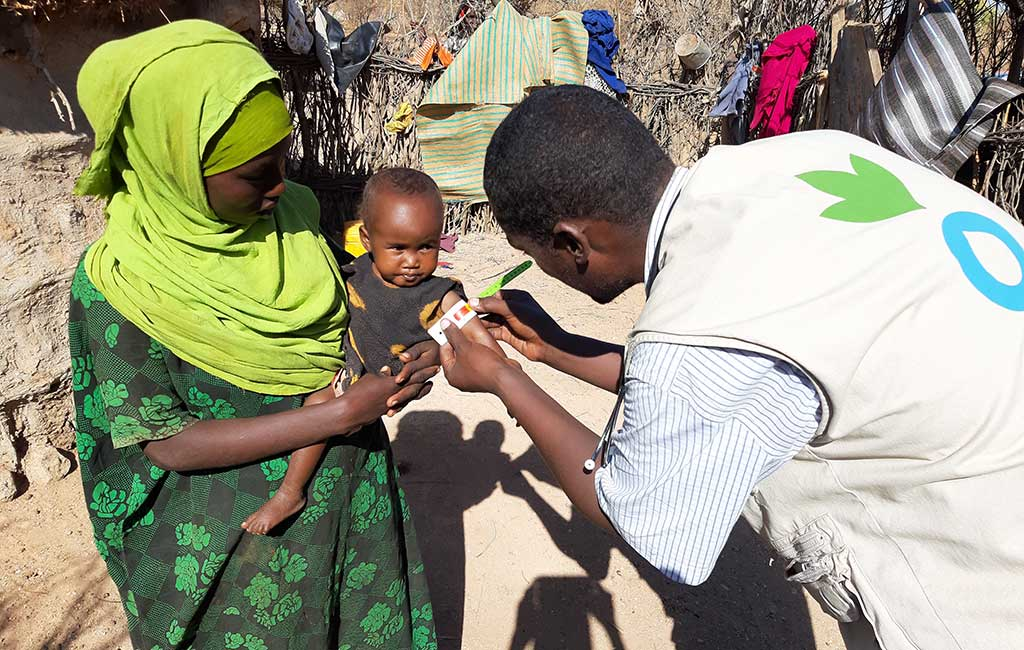 Suldana is screened for malnutrition by an Action Against Hunger staff member in Somalia.