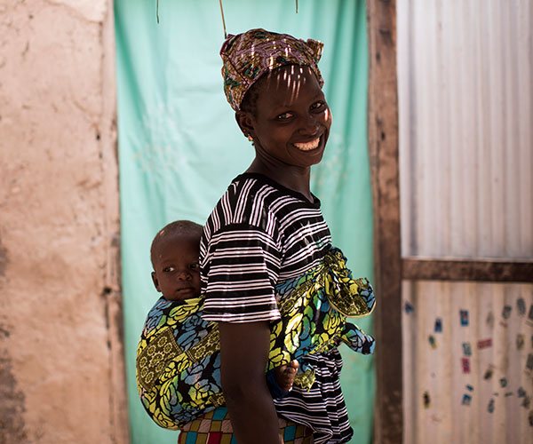 Simbo and his mum in Mali. Simbo recovered from life-threatening hunger after receiving support from Action Against Hunger.