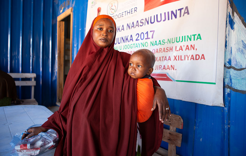 Mohamed with his mum Hafsa at an Action Against Hunger treatment centre in Mogadishu, Somalia.