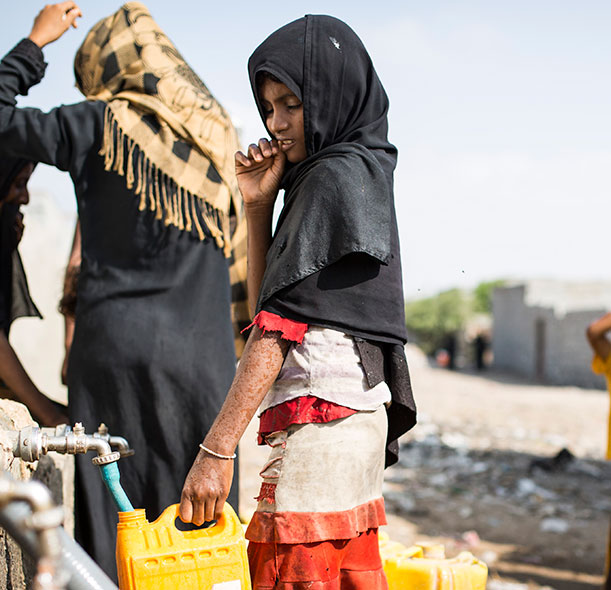 A girl collecting water in Yemen.