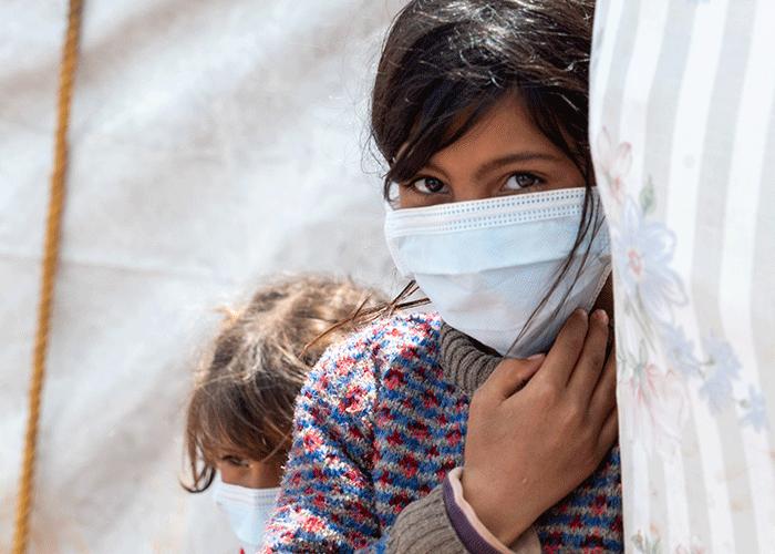 Bushra from Yemen wears a mask provided by Islamic Relief.
