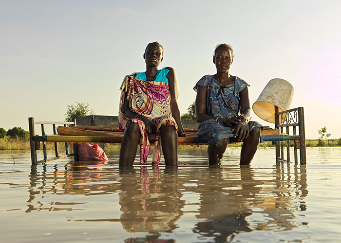 Nyagout Lok, 46, and her pregnant daughter, Nyakoang Majok, 28, set up a bed in the water – there is no room for both of them to sleep inside their temporary shelter in South Sudan.