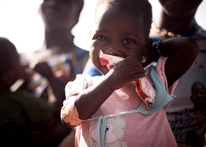 A girl eats ready-to-use therapeutic food in Mali.