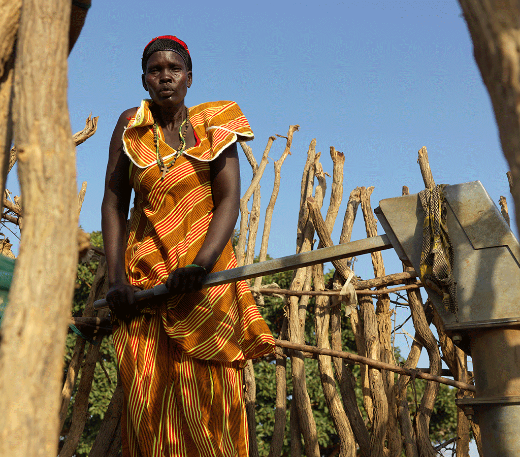 Nyanut collecting water at Baackuel Village, Malualkon, South Sudan.