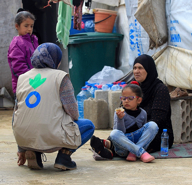 Action Against Hunger staff with Syrian family