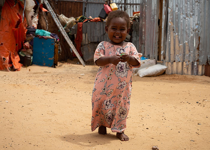 Halima walks around her home in an internally displaced people camp in Somalia. Halima recovered from life-threatening malnutrition thanks to the support of Action Against Hunger.