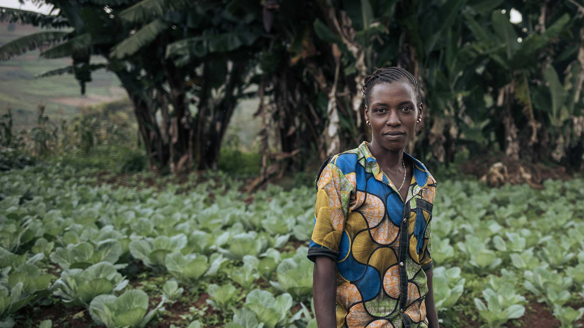 Alice in a cabbage field supported by Action Against Hunger in the Democratic Republic of Congo..