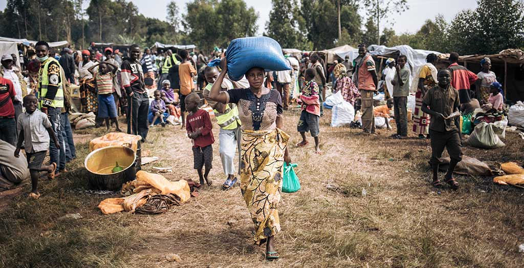 A woman collects food at a fair organised by Action Against Hunger in Democratic Republic of Congo.