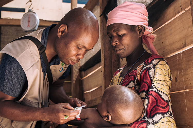 Georgine with her 27-month-old son, David who was treated at an Action Against Hunger-supported health centre for severe acute malnutrition in Democratic Republic of Congo.